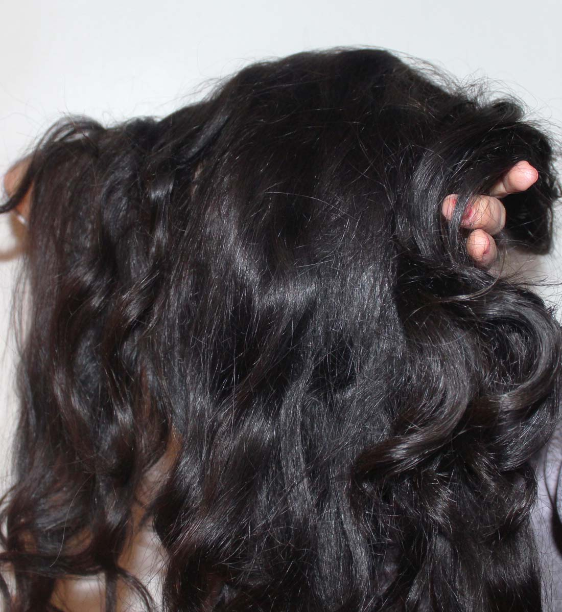 masse de cheveux dense et lumineuse apres le shikakai